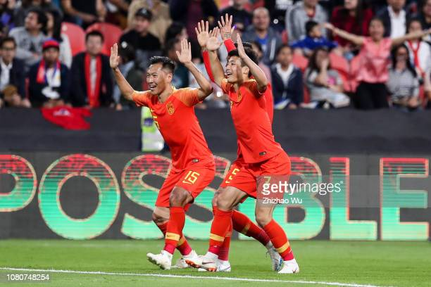 Wu Lei of China celebrates his scoring with teammates during the AFC Asian Cup Group C match between the Philippines and China at Mohammed Bin Zayed...