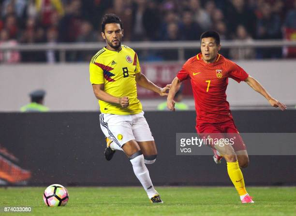 Wu Lei of China National Team and Abel Aguilar of Columbia National Team compete for the ball during the international friendly match between China...
