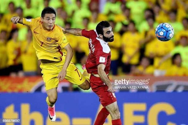 Wu Lei of China vies for the ball with Amro Jeniat of Syria during the FIFA World Cup 2018 Group A third round qualifying match between Syria and...