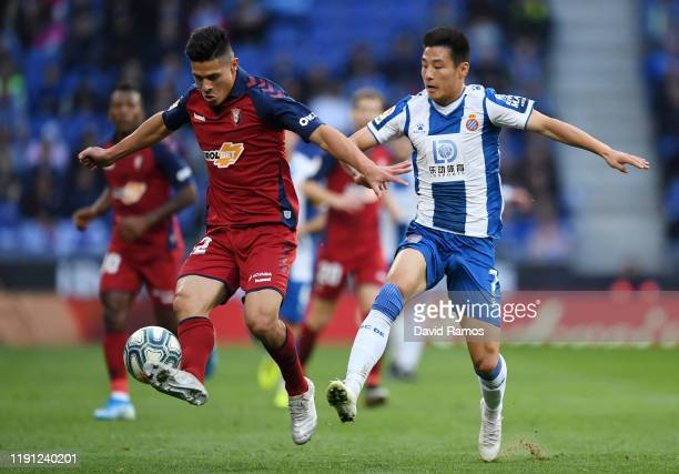 Wu Lei of Espanyol and Facundo Roncaglia of Osasuna clash during the La Liga match between RCD Espanyol and CA Osasuna at RCDE Stadium on December 01...