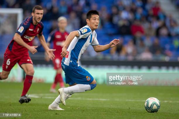 Wu Lei of Espanyol chased by Oier Sanjurjo of Osasuna during the Espanyol V Osasuna La Liga regular season match at RCDE Stadium on December 1st 2019...
