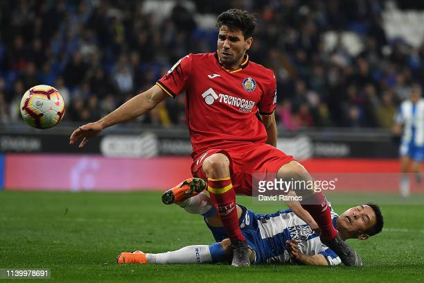 Wu Lei of Espanyol loses out to Leandro Cabrera of Getafe looks on during the La Liga match between RCD Espanyol and Getafe CF at RCDE Stadium on...