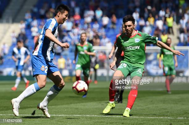 Wu Lei of RCD Espanyol battles for possession with Ximo Navarro of Deportivo Alaves during the La Liga match between RCD Espanyol and Deportivo...