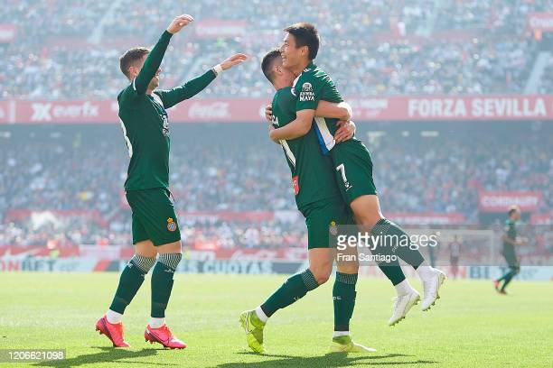 Wu Lei of RCD Espanyol celebrates scoring his team's second goal with team mates during the Liga match between Sevilla FC and RCD Espanyol at Estadio...