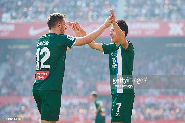 Wu Lei of RCD Espanyol celebrates scoring his team's second goal with Marc Roca during the Liga match between Sevilla FC and RCD Espanyol at Estadio...