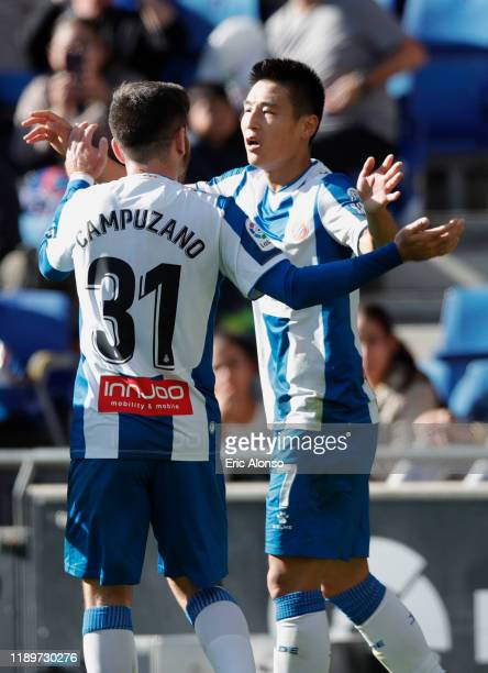 Wu Lei of RCD Espanyol celebrates with Victor Campuzano after scoring his side's first goal during the Liga match between RCD Espanyol and Getafe CF...