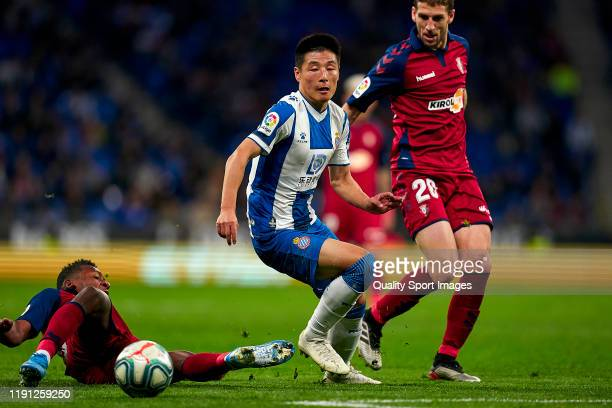 Wu Lei of RCD Espanyol competes for the ball with Darko and Estupinan of CA Osasuna during the Liga match between RCD Espanyol and CA Osasuna at RCDE...