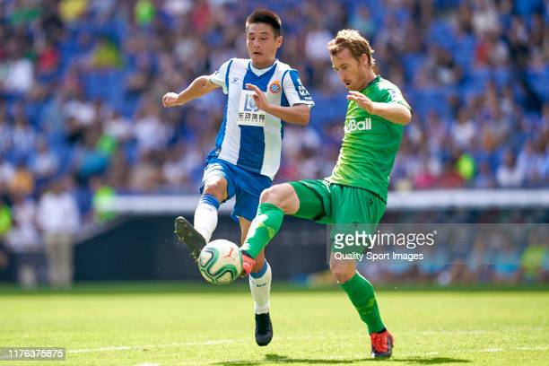 Wu Lei of RCD Espanyol competes for the ball with David Zurutuza of Real Sociedad during the Liga match between RCD Espanyol and Real Sociedad at...