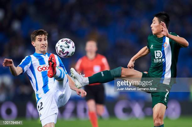 Wu Lei of RCD Espanyol duels for the ball with Aihen Muñoz of Real Sociedad during the Copa del Rey Round of 32 match between Real Sociedad and RCD...