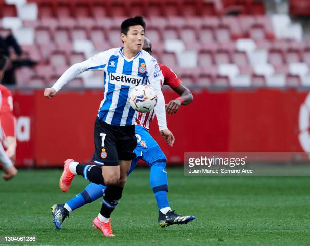 Wu Lei of RCD Espanyol duels for the ball with Jean-Sylvain Babin of Real Sporting Gijon during the Liga Smartbank match betwen Real Sporting and RCD...