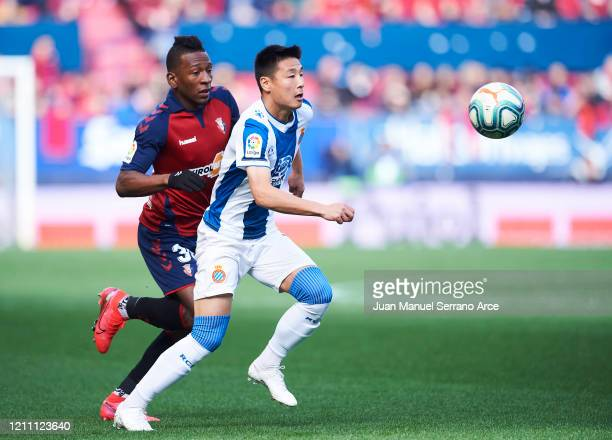 Wu Lei of RCD Espanyol duels for the ball with Pervis Estupinan of CA Osasuna during the Liga match between CA Osasuna and RCD Espanyol at El Sadar...