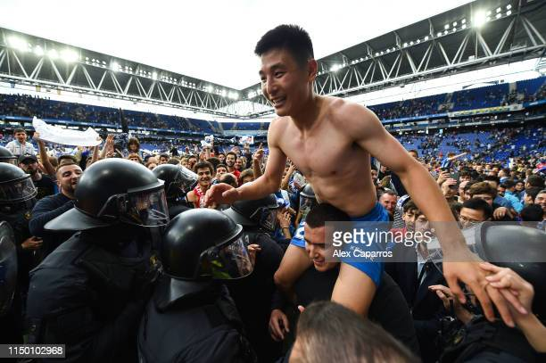 Wu Lei of RCD Espanyol leaves the pitch on a fan's shoulders at the end of the La Liga match between RCD Espanyol and Real Sociedad at RCDE Stadium...