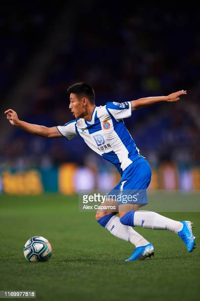 Wu Lei of RCD Espanyol runs with the ball during the UEFA Europa League Play Off match between Espanyol and Zoryan Luhansk at RCDE Stadium on August...