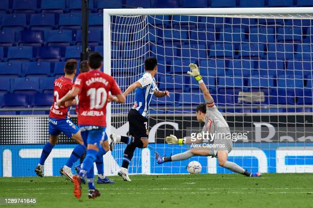 Wu Lei of RCD Espanyol scores the opening goal during the LaLiga SmartBank match between RCD Espanyol and Real Sporting de Gijon at RCDE Stadium on...