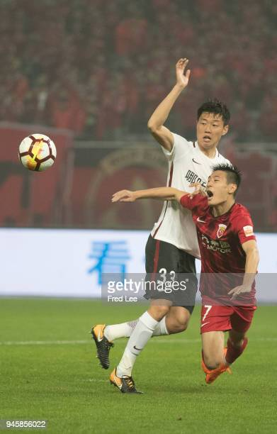 Wu lei of Shanghai SIPG and Gao Zhunyi of Hebei China Fortune in action during 2018 China Super League match between Shanghai SIPG and Hebei China...