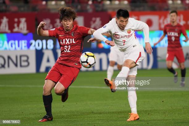 Wu Lei of Shanghai SIPG and Koki Anzai of Kashima Antlers compete for the ball during the AFC Champions League Round of 16 first leg match between...