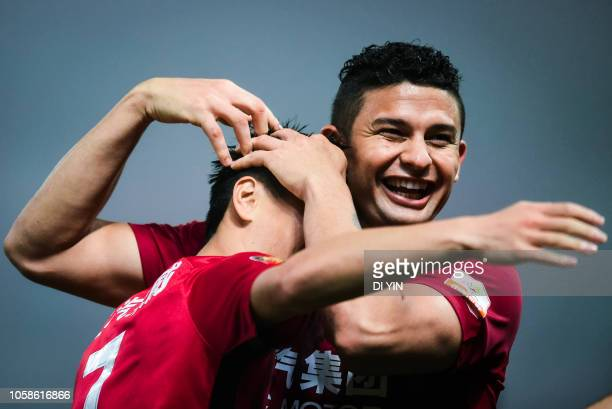 Wu Lei of Shanghai SIPG celebrates a goal with Elkeson de Oliveira Cardoso during the 2018 Chinese Super League title match between Shanghai SIPG v...
