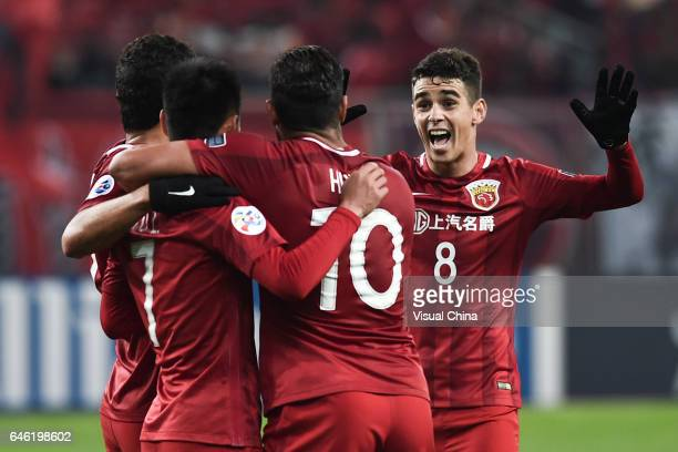 Wu Lei of Shanghai SIPG celebrates with team mates after scoring his team's fifth goal during the AFC Champions League 2017 Group F match between...