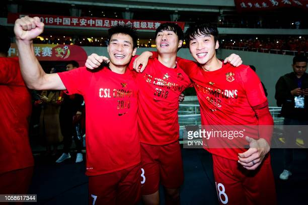 Wu Lei of Shanghai SIPG celebrates with teammates after winning the Chinese Super League championship against Beijing Renhe during the 2018 Chinese...