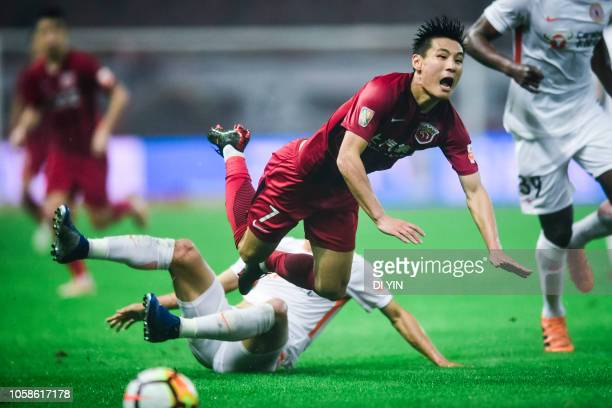 Wu Lei of Shanghai SIPG is tackled during the 2018 Chinese Super League title match between Shanghai SIPG v Beijing Renhe at Shanghai Stadium on...