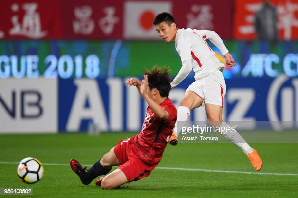 Wu Lei of Shanghai SIPG shoots at goal during the AFC Champions League Round of 16 first leg match between Kashima Antlers and Shanghai SIPG at...