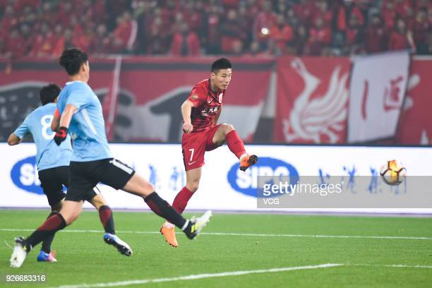 Wu Lei of Shanghai SIPG shoots the ball during the 2018 Chinese Football Association Super League first round match between Shanghai SIPG and Dalian...