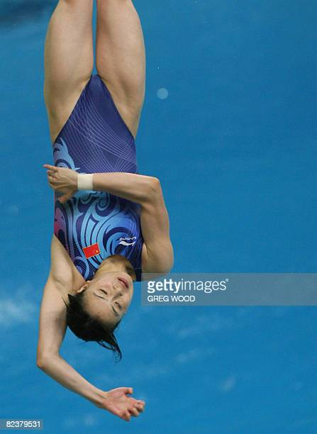 Wu Minxia of China dives during the women's 3m springboard diving semifinal at the National Aquatics Center during the 2008 Beijing Olympic Games in...