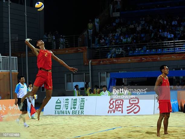 Wu Penggen of China serves a shot during the beach volleyball men's final match at the 16th Asian Games in Guangzhou on November 24 2010 Xu Linyin...