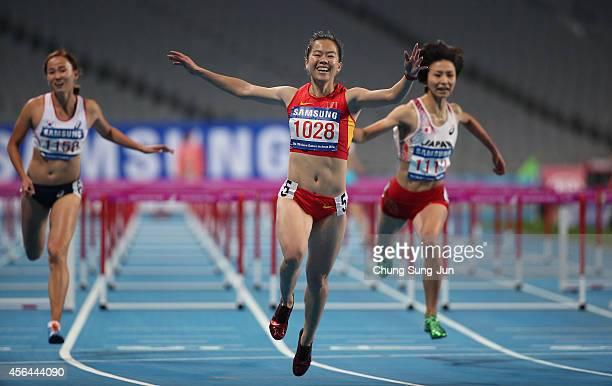 Wu Shuijiao of China celebrates after winning the women's 100m hurdles final during day twelve of the 2014 Asian Games at Incheon Asiad Main Stadium...