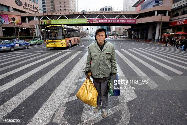 Wu Wenyi poses for a photograph at a crossroads on February 17 2009 in Shanghai China Wu Wenyi came to Shanghai from Quanjiao Anhui province two...