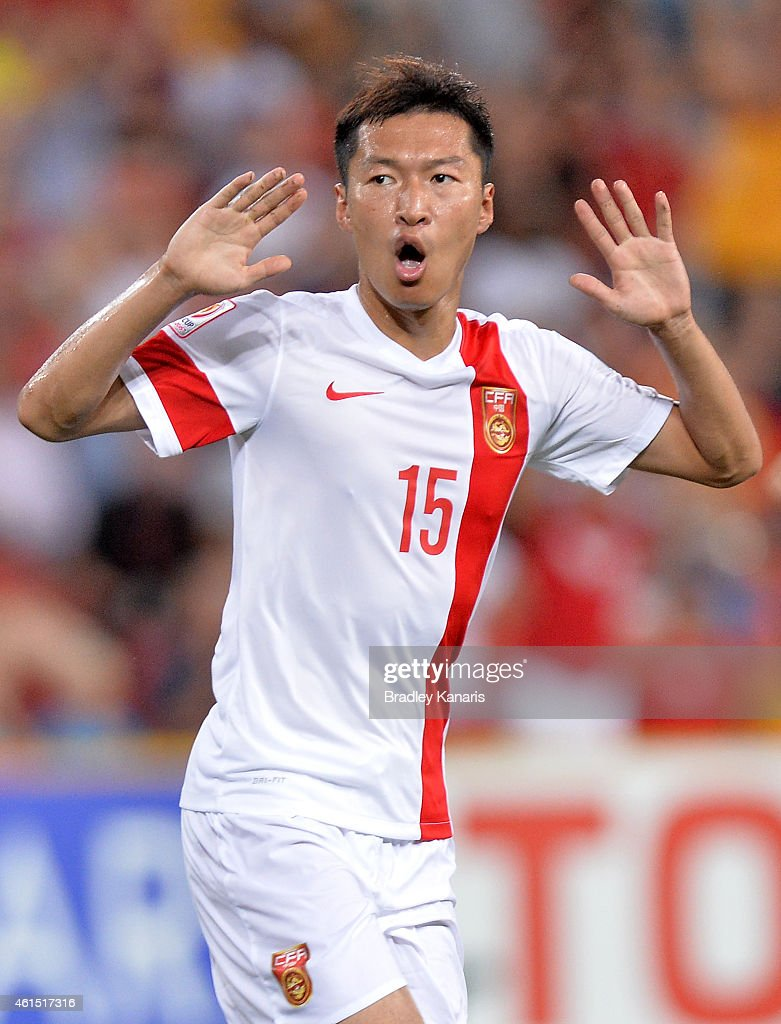 Wu Xi of China celebrates after scoring a goal during the 2015 Asian Cup match between China PR and Uzbekistan at Suncorp Stadium on January 14, 2015 in Brisbane, Australia.