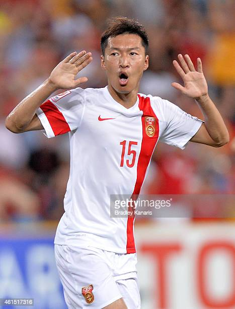 Wu Xi of China celebrates after scoring a goal during the 2015 Asian Cup match between China PR and Uzbekistan at Suncorp Stadium on January 14, 2015...