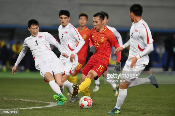 Wu Xi of China controls the ball under pressure of North Korean defense compete for the ball during the EAFF E1 Men's Football Championship between...