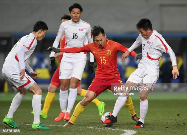 Wu Xi of China controls the ball under pressure of North Korean defense during the EAFF E1 Men's Football Championship between China and North Korea...
