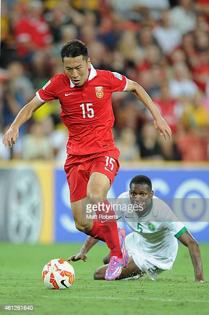 Wu Xi of China PR takes on the defence during the 2015 Asian Cup match between Saudi Arabia and China PR at Suncorp Stadium on January 10 2015 in...