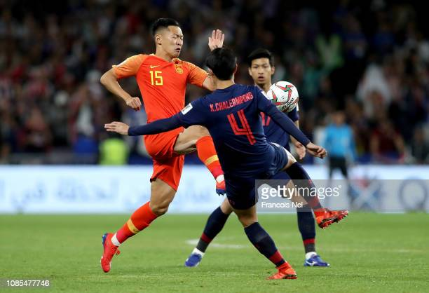 Wu Xi of China tackles with Chalermpong Kerdkaew of Thailand during the AFC Asian Cup round of 16 match between Thailand and China at Hazza Bin Zayed...