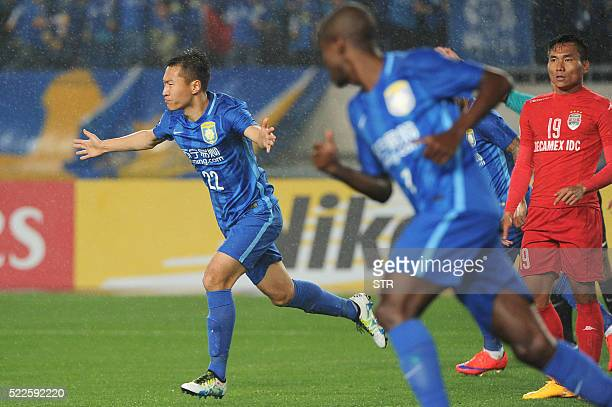 Wu Xi of China's Jiangsu FC celebrates a goal against Vietnam's Becamex Binh Duong during their AFC Champions League group stage football match in...