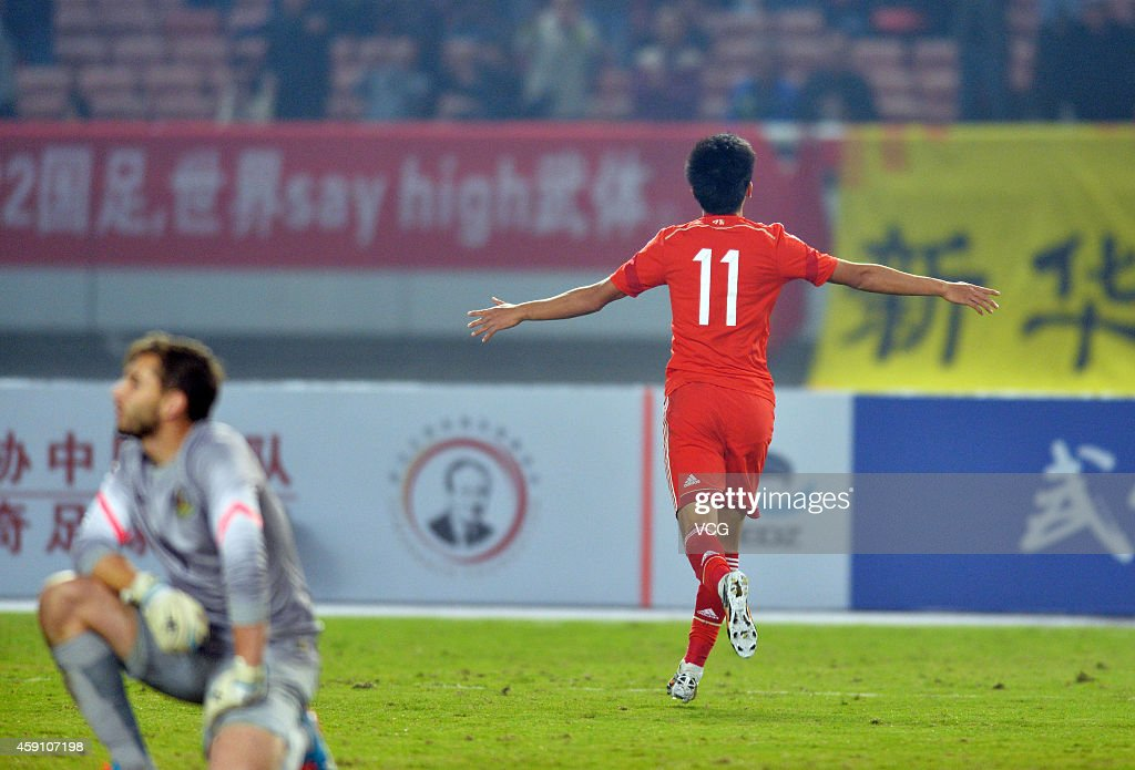 Wu Xinghan #11 of China celebrates after scoring his team's second goal during the match between China U22 and Australia U22 on day three of the 'Wuhan City of Automobile' International Youth Football Tournament at Wuhan Sports Center Stadium on November 16, 2014 in Wuhan, China.