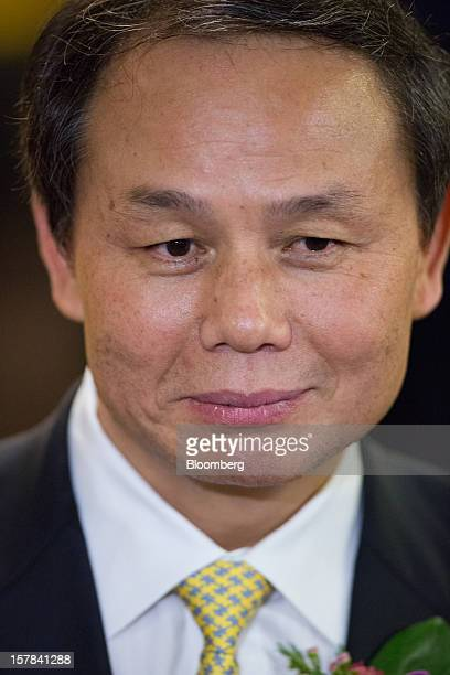 Wu Yan chairman of People's Insurance Company of China Ltd attends a news conference after the company's Hong Kong stock exchange listing ceremony in...