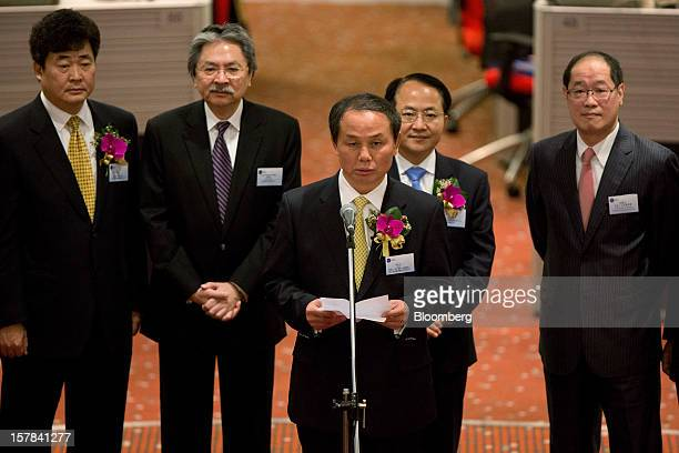 Wu Yan chairman of People's Insurance Company of China Ltd center makes a speech during the company's Hong Kong stock exchange listing ceremony in...