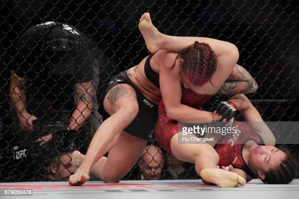 Wu Yanan fights with Gina Mazany during the UFC Fight Night at MercedesBenz Arena on November 25 2017 in Shanghai China