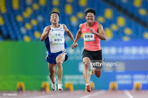 Wu Zhiqiang of Hubei and Su Bingtian of Guangdong compete in the Men's 100m Sprint Final during China's 14th National Games at Xi'an Olympic Center...