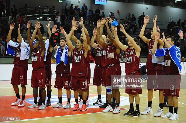 Wuerzburg players celebrate after the Beko BBL Bundesliga match between LTi Giessen 46ers and s Oliver Baskets at SporthalleOst on October 8 2011 in...