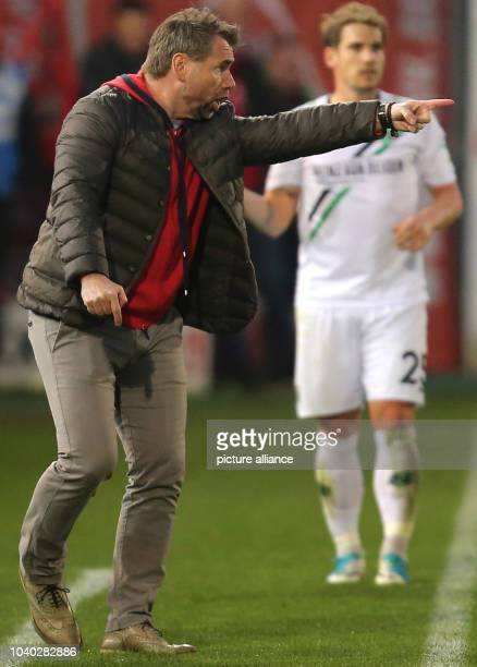 Wuerzburg's coach Bernd Hollerbach reacts during the German 2nd divisionBundesliga soccer match between Wuerzburger Kickers and Hannover 96 in the...