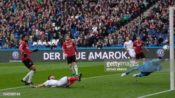 Wuerzburgs Elia Soriano shooting the 0:1 goal against Hanover's goalkeeper Samuel Sahin-Radlinger during the 2nd Bundesliga soccer match between...