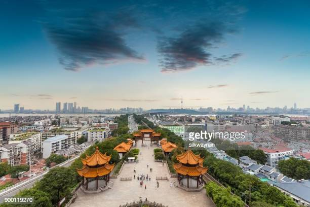 wuhan cityscape at dusk - wuhan stock photos and pictures