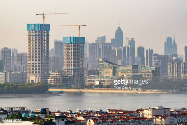 wuhan cityscape at sunset - wuhan stock pictures, royalty-free photos & images
