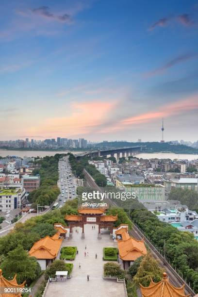wuhan cityscape in sunset - wuhan stock photos and pictures