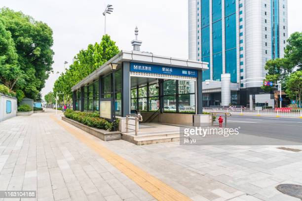 wuhan, hubei province, wuhan metro station ground exit. - wuhan stock pictures, royalty-free photos & images