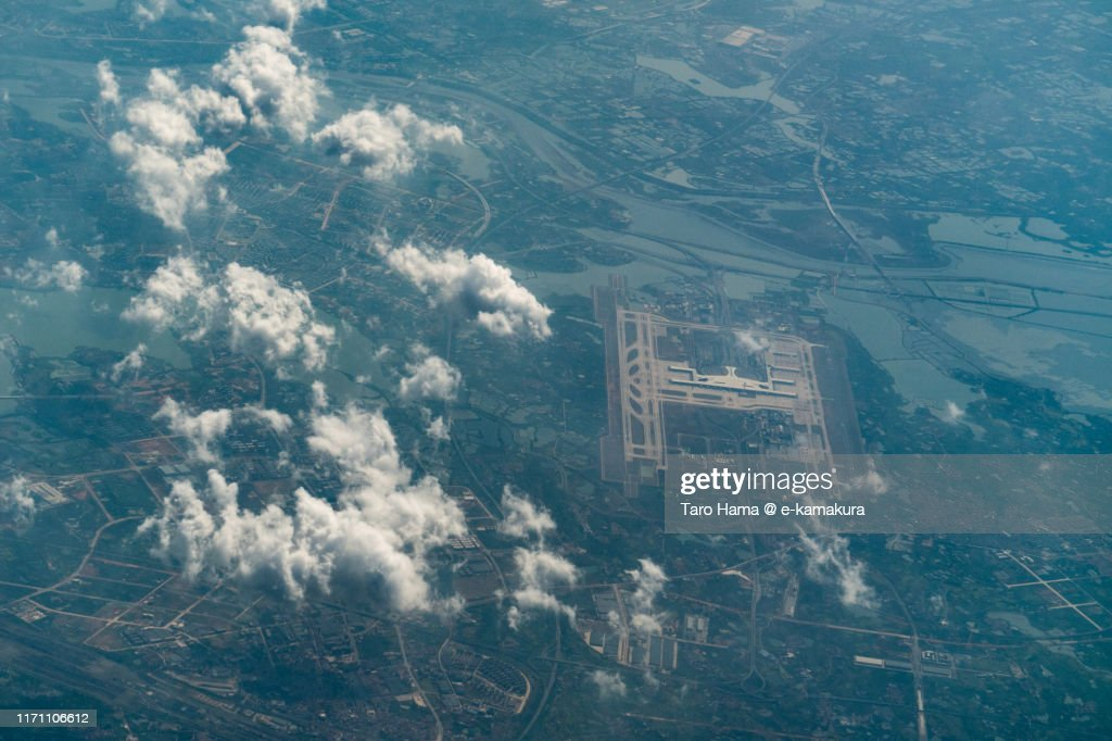 Wuhan Tianhe International Airport in Hubei Province of China daytime aerial view from airplane : Stock Photo